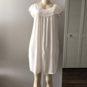 New woman's cream colored dress